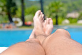 Men's legs close-up against  in the pool — Foto Stock