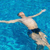 Close-up portrait of Young man in pool  — Stock Photo