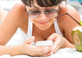 Smiling young woman with a telephone — Stock Photo