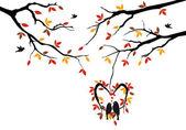 Aves en otoño árbol en nido de corazón, vector — Vector de stock