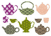 Tea pots and cups with asian pattern, vector — Stock Vector