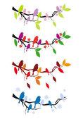 Birds on tree in four seasons, vector set — Stock Vector