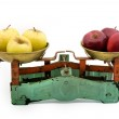 Old scales with yellow and red apples — Stock Photo #1408888