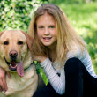 Young girl with a dog — Stock Photo