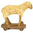 Stock Photo: Straw and wood shaving toy lamb