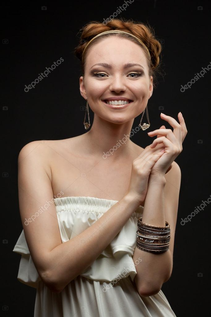 Portrait of smiling beautiful young woman on black — Stock Photo #13962838