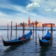 Gondolas and San Giorgio Maggiore church on Grand Canal in Venic — Stock Photo #21831607