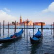 Gondolas and San Giorgio Maggiore church on Grand Canal in Venic - Stock Photo