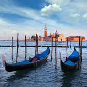 Gondolas and San Giorgio Maggiore church on Grand Canal in Venic — Stock Photo