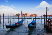 Gondolas and San Giorgio Maggiore church on Grand Canal in Venic — Foto de Stock