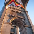 Foto de Stock  : Flag in Triumphal Arch in Cinquantennaire Parc in Brussels , Bel