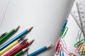 Notebook with pencils and clips — Stock Photo