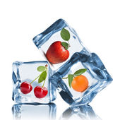 Fruits in ice cubes isolated on white — Stock Photo