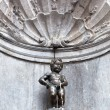 Manneken Pis statue in Brussels - Stock Photo