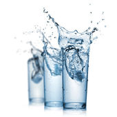 Water splash in glasses isolated on white — Stock Photo
