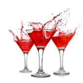 Red cocktails with splash isolated on white — Stock Photo