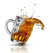 Beer splash in glass isolated on white — Stock Photo