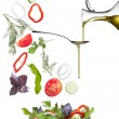 Falling vegetables for salad and oil isolated — Stock Photo