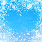 Blue winter background with heart and snowflakes — Stock Photo