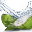 Green coconut with water splash isolated on white — Stock Photo