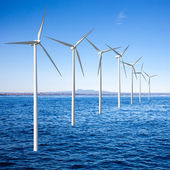 Wind generators turbines in the sea — Stock Photo