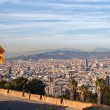 Aerial view of Barcelona city with flag of Spain — Stockfoto
