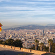 Aerial view of Barcelona city with flag of Spain — Stock Photo