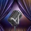 Stage with open curtains and microphone — ストック写真