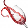 Splash of red wine in wineglass isolated on white — Stock Photo #35138753