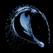 Water splash isolated on black background — Stock Photo