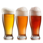 Different beer in glasses isolated on white background — Stock Photo