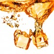 Ice cubes dropped into orange water with splash isolated on whit — Lizenzfreies Foto