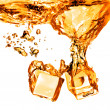 Ice cubes dropped into orange water with splash isolated on whit — Stock Photo #36590889