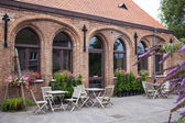 Small cafe in Bruges, Belgium — Stockfoto