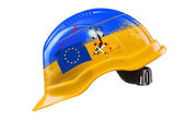 Blue and yellow hard hat with cracks, scratches and EU flag. KIE — Foto Stock