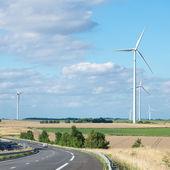 Wind generator turbine on summer landscape — Foto Stock