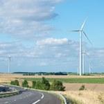 Wind generator turbine on summer landscape — Stock Photo #36946583