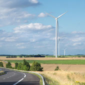 Wind generator turbine on summer landscape — Stock Photo