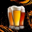 Different beer in glasses wish splash isolated on black backgrou — Stock Photo