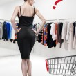 Elegant woman shopping in a store — Stock Photo #39621511