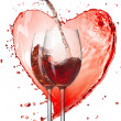 Stock Photo: Red wine pouring into glasses with splash against heart isolated