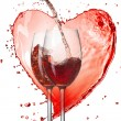 Red wine pouring into glasses with splash against heart isolated — Stock Photo
