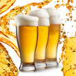 Stock Photo: Beer in glasses isolated on white background