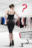 Elegant woman shopping in a store — Foto Stock