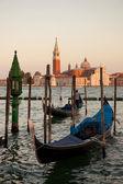 Gondolas and San Giorgio Maggiore church on Grand Canal in Venic — Stock Photo