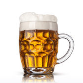 Beer in glass isolated on white background — Stock Photo
