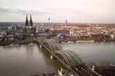 View of Koeln, Germany. Gothic cathedral and steel bridge over r — Stockfoto