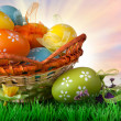 Color easter eggs in basket against sky and clouds — Stock Photo #41265583