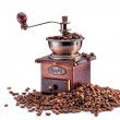 Retro manual coffee mill on roasted coffee beans isolated — Stock Photo
