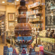 Chocolate fountain in belgium shop — Stock Photo #42047063